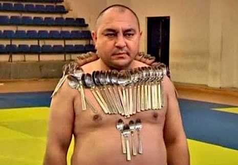 'Magnetic Man' breaks world record for holding spoons on his body