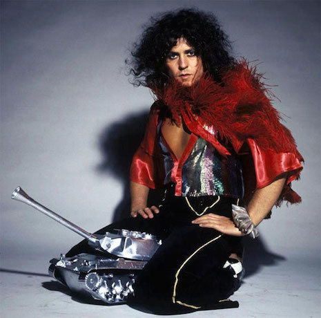 Marc Bolan riding a tiny shiny tank