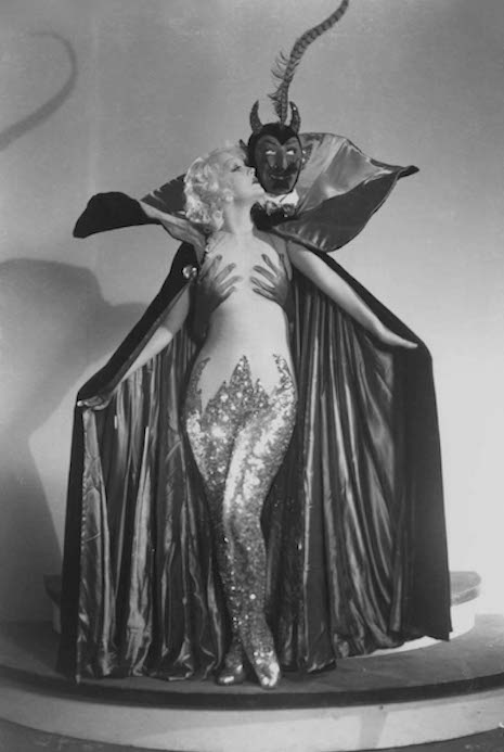 Actress Marian Martin and a burlesque cape featuring our pal, Satan, 1930s