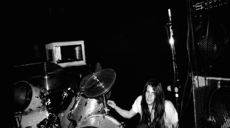 Drummer Chad Channing crawling up to his kit at Man Ray in Cambridge, Massachusetts, April 18th, 1990