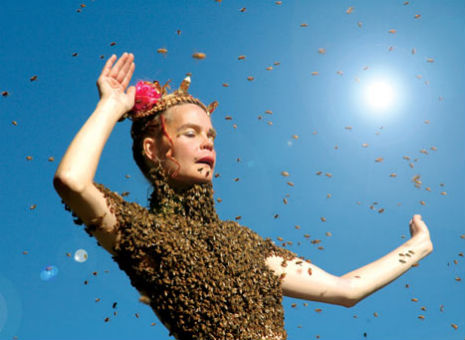 'Bee Queen' dances and sips tea while wearing 12,000 live honey bees