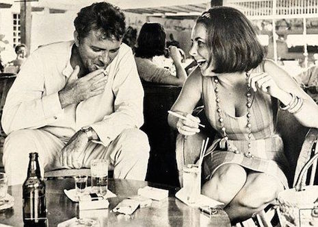 Richard Burton and Elizzabeth Taylor boozing together