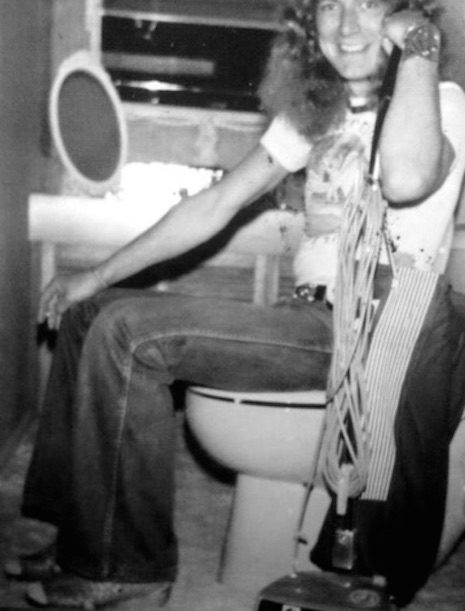 Robert Plant of Led Zeppelin on the toilet