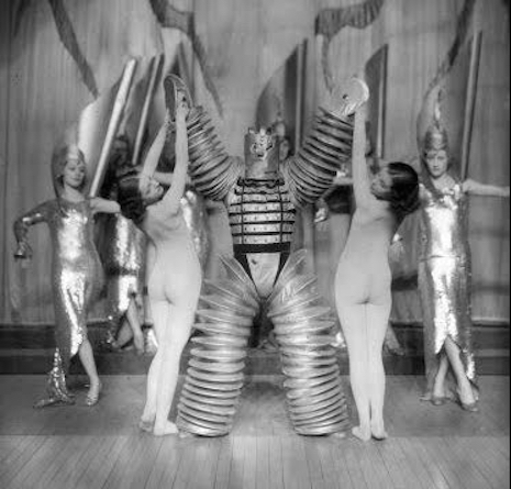 Nude dancers and a robot, 1920s
