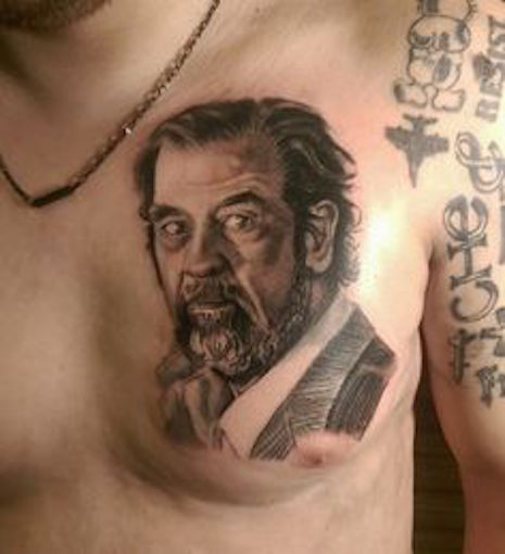 Saddam Hussein portrait tattoo