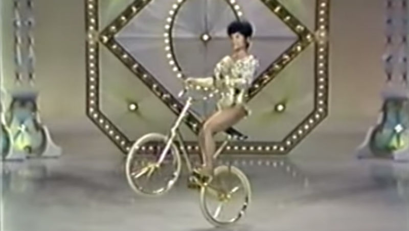 Awesome woman performs bike tricks 20 years before BMX flatland-style, 1965