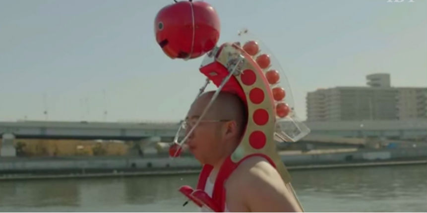 Japanese juice company invents wearable robot that feeds you tomatoes while you run