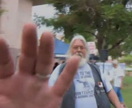 'Commie!': Racist Tea party goon squad menace Arizona activist at anti-immigration rally