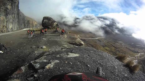 Bikes stop to admire the Death Road in Bolivia