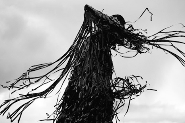 Dark, foreboding figures made from VHS tapes