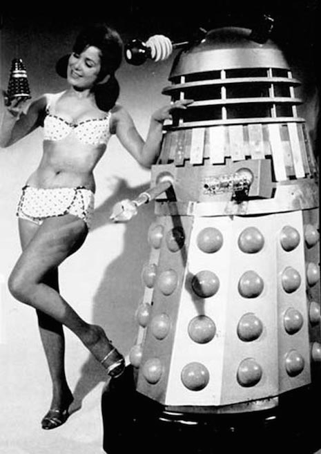 Bikini girls with a Dalek robot, 1950s