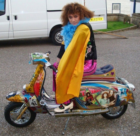 Danielz, the vocalist for the T. Rex tribute band, T.Rextasy sitting on the customized Marc Bolan Lambretta scooter