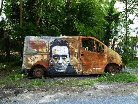 Joe Strummer mural painted on the side of a van by French artist, Jef Aerosol
