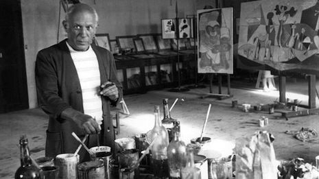 Pablo Picasso in his studio and bottles of Green Fairy